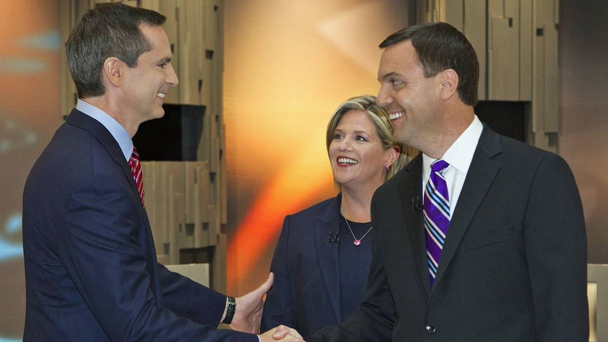 Ontario Liberal Leader Dalton McGuinty, left, NDP Leader Andrea Horwath, centre, and PC Leader Tim Hudak shake hands moments before the Ontario election leaders debate in Toronto on Sept. 27, 2011.