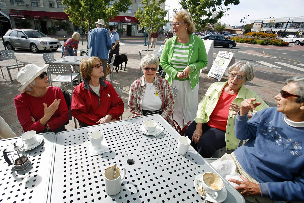 Elizabeth May introduces herself to members of the Peninsula Newcomers Club outside a cafe in Sidney, B.C., on Tuesday. The Green Party Leader announced she will seek the nomination in the federal election of Saanich-Gulf Islands.