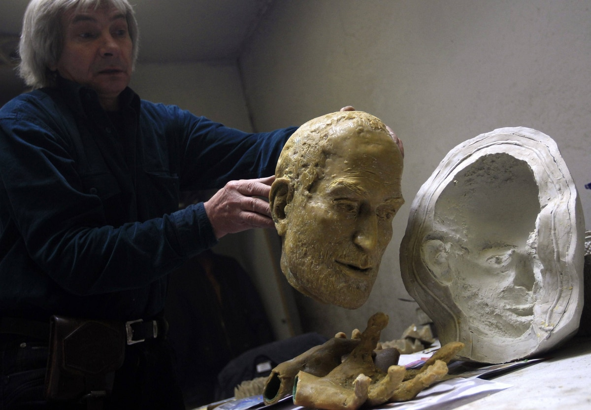 In his Budapest studio, sculptor Erno Toth prepares a wax model for a new bronze statue of the late Apple co-founder Steve Jobs. Here, the sculptor removes the model for the head from a plaster mould.