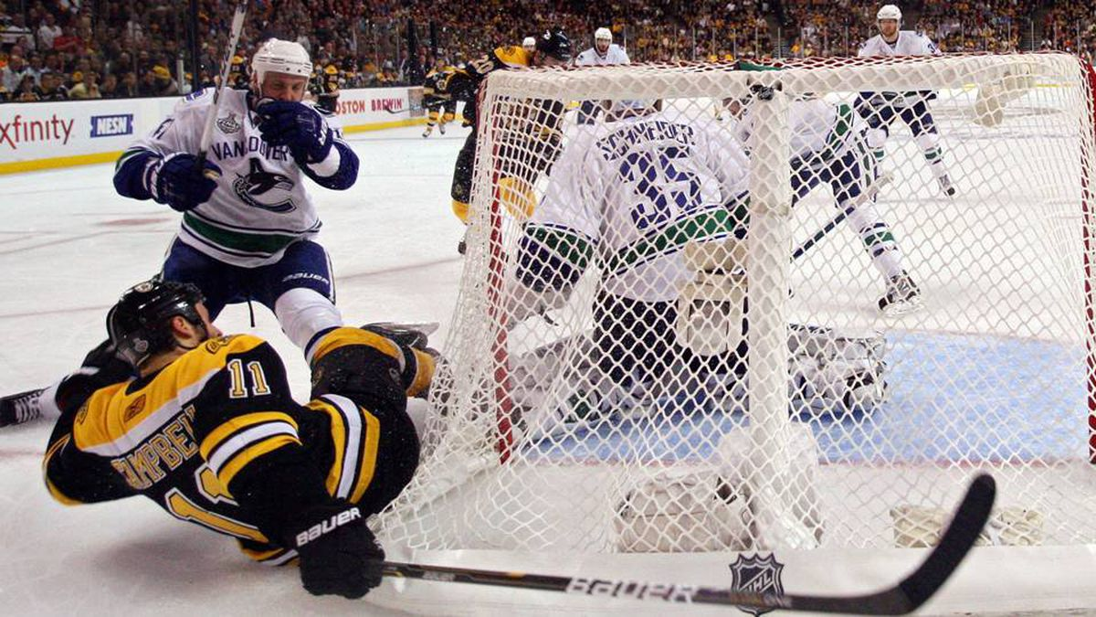 Gregory Campbell of the Boston Bruins falls to the ice against the Vancouver Canucks during Game 6.