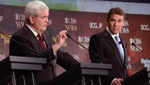 Republican presidential candidate Newt Gingrich, left, speaks while fellow candidate Rick Perry awaits his turn during the the CBS News/National Journal foreign policy debate in Spartanburg, S.C., on Nov. 12, 2011.