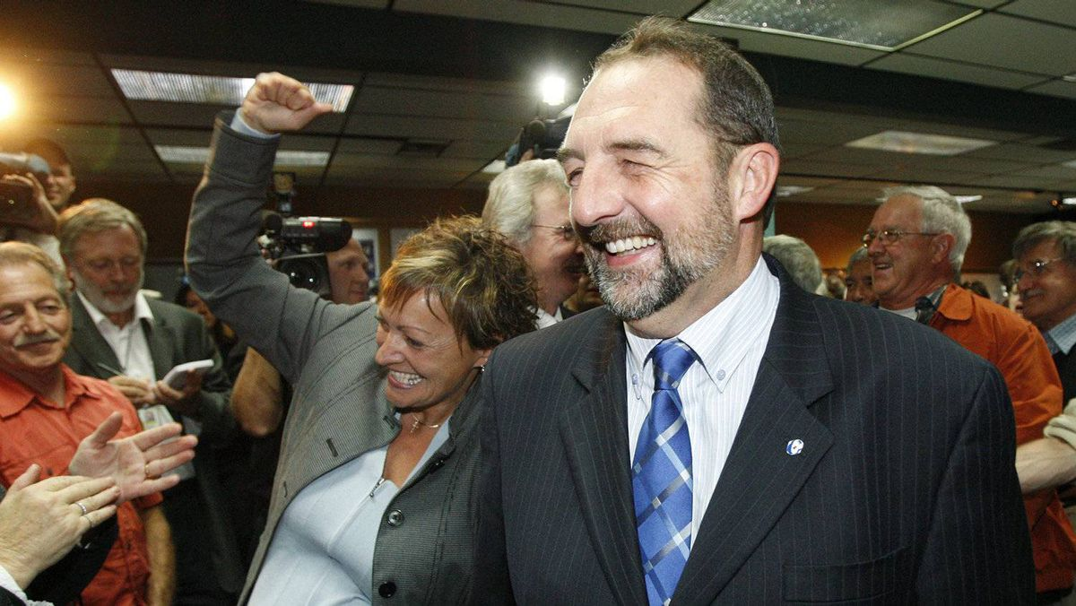 Denis Lebel arrives at a party with his wife Danielle after winning a by-election in Roberval-Lac-St-Jean on Sept. 17, 2007.