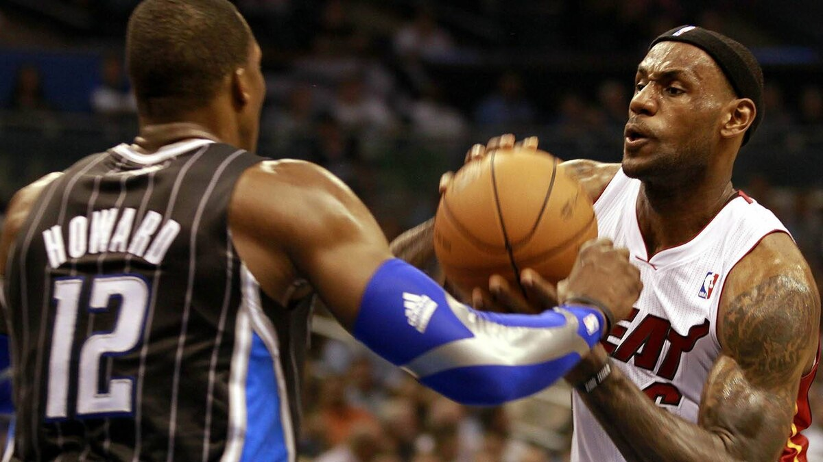 Forward LeBron James #6 (R) of the Miami Heat drives against center Dwight Howard #12 of the Orlando Magic at Amway Arena on February 3, 2011 in Orlando, Florida. (Photo by Marc Serota/Getty Images)