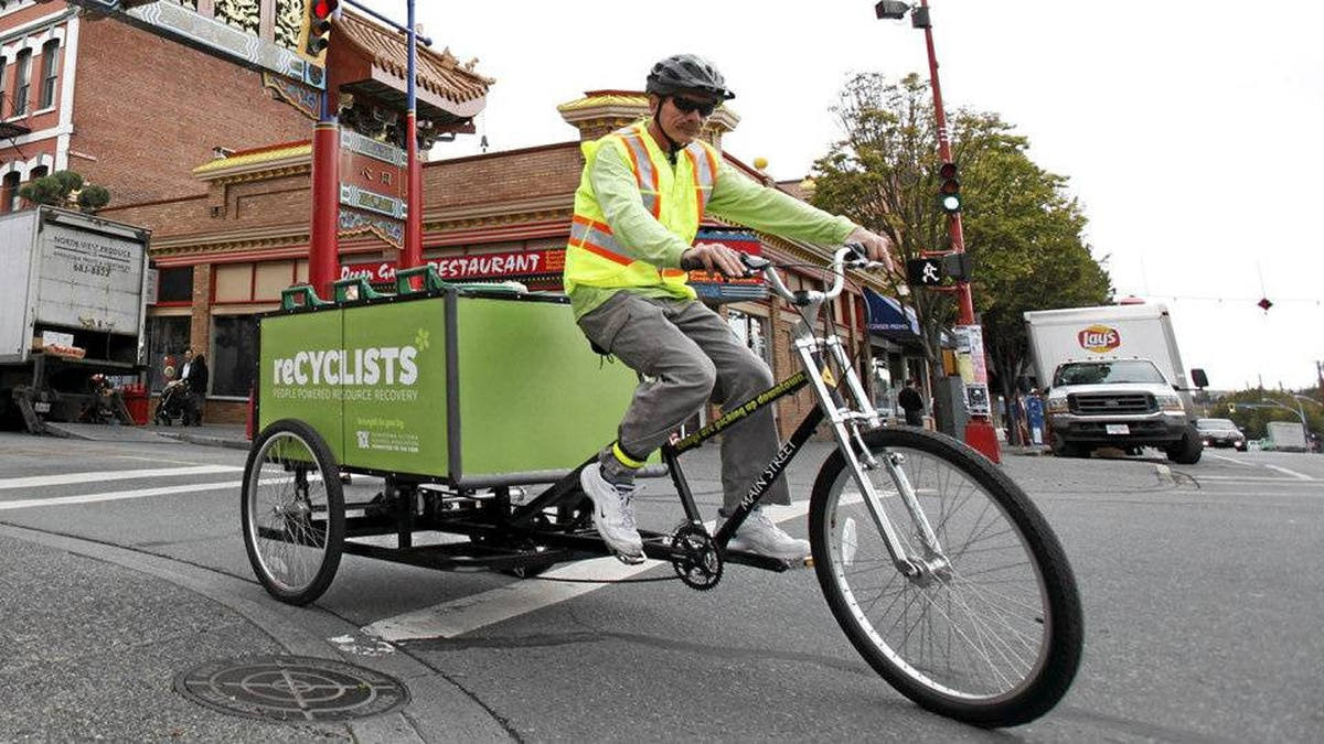 Darren Douglas works for reCyclists, a company that collects organic waste weekly from Victoria businesses via bicycles.