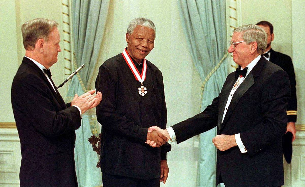 Mr. Mandela shakes hands with govenor-general Romeo LeBlanc as prime minister Jean Chretien looks on. Mr. Mandela received his honorary Companion of the Order of Canada at a ceremony at Rideau Hall in Ottawa, September 24, 1998.