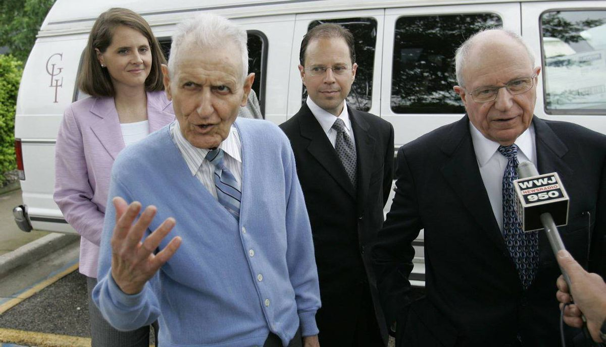 """Assisted suicide advocate Jack Kevorkian, wearing blue sweater, standing next to his attorney Mayer Morganroth, far right, addresses the media after walking out of the Lakeland Correctional Facility in Coldwater, Mich., Friday, June 1, 2007. Behind Kevorkian are paralegal Sarah Tucker and attorney Jeffrey Morganroth. Kevorkian, the retired pathologist dubbed """"Dr. Death"""" after claiming he had participated in at least 130 assisted suicides, left prison after eight years Friday still believing people have the right to die. (AP Photo/Carlos Osorio, pool)"""