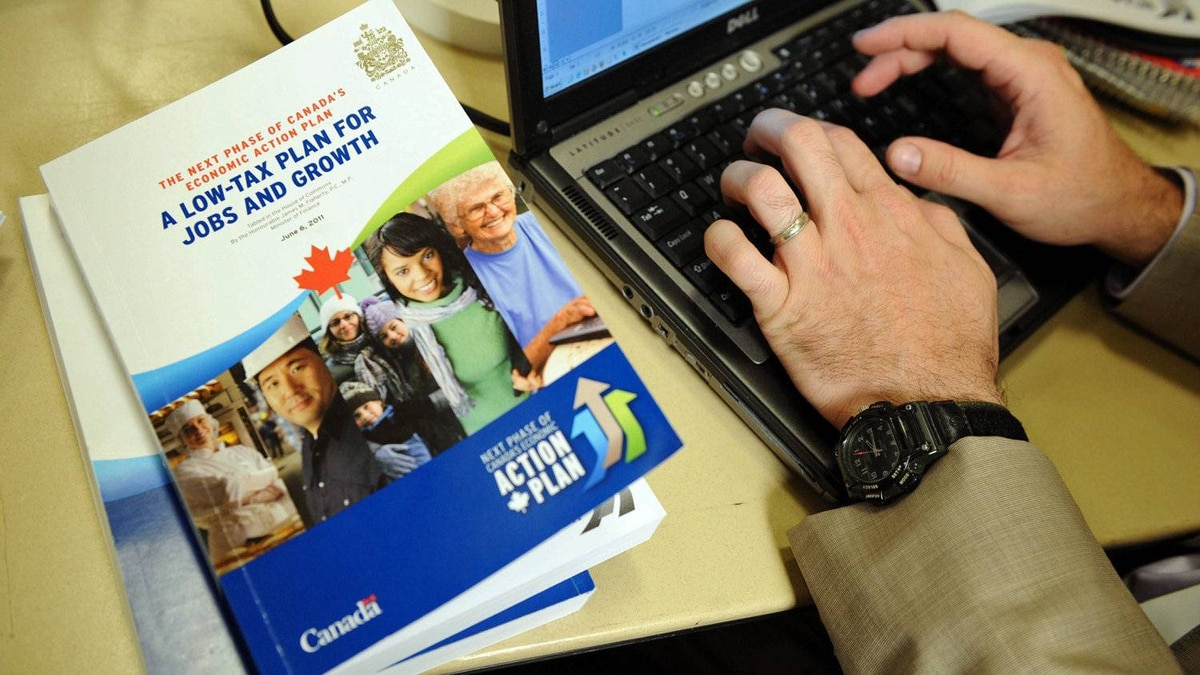 A reporter files a story on the federal budget during the media lock-up prior to Finance Minister Jim Flaherty's speech in the House of Commons on June 6, 2011.