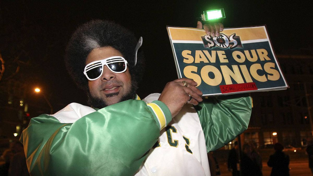 Kris Brannon of Tacoma, Washington, a fan of former NBA franchise the Seattle Supersonics, holds up a 'Save our Sonics' memorabilia sign during a campaign rally for Republican presidential candidate Rick Santorum in Tacoma in this photo taken February 13, 2012. City of Seattle officials said February 15 that an announcement will be made on February 16 about a possible basketball arena deal that may bring back an NBA team to Seattle. Picture taken February 13, 2012.