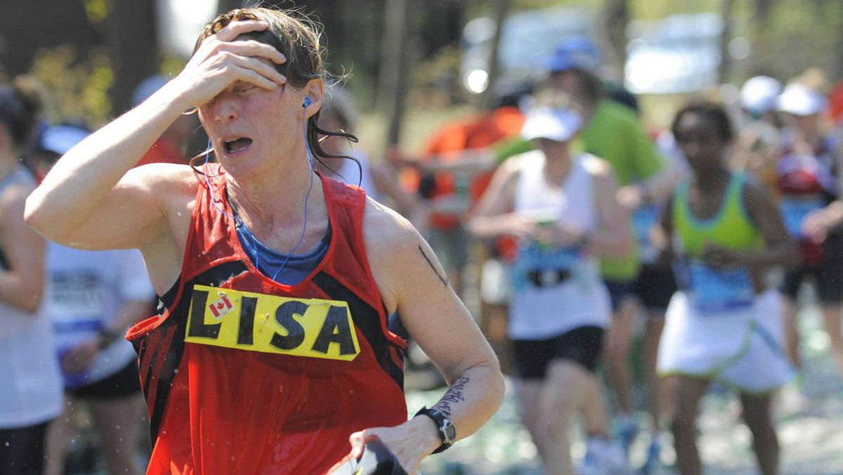 A runner feels the heat along the route of the 116th Marathon in Wellesley, Massachusetts April 16, 2012.