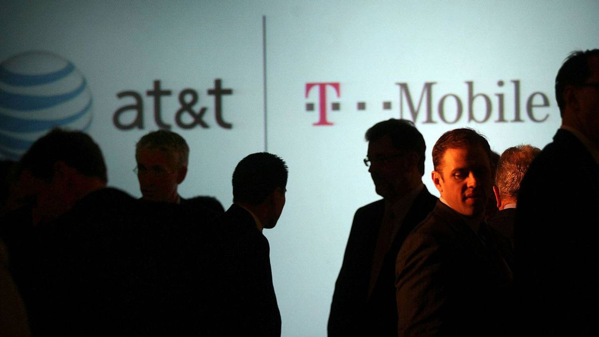 NEW YORK, NY - MARCH 21: Executives at AT&T attend a news conference where it was announced that AT&T Inc. will be buying its wireless rival T-Mobile USA from Deutsche Telekom AG for $39 billion in cash and stock on March 21, 2011 in New York City.