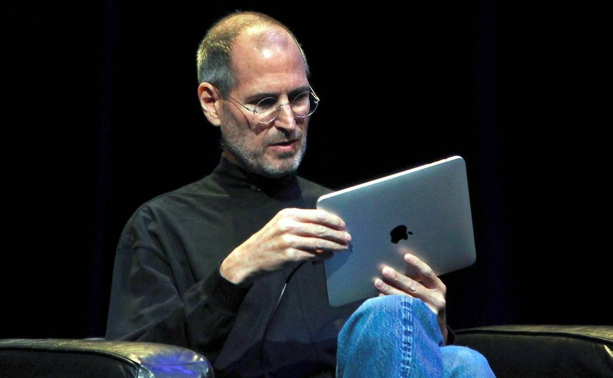 """Apple Chief Executive Officer Steve Jobs holds the new """" iPad"""" during the launch of the tablet computing device in San Francisco, Calif."""