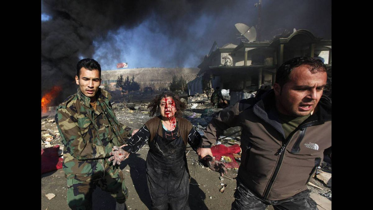 A victim is taken away from the site of a bomb blast in Kabul, December 15, 2009.