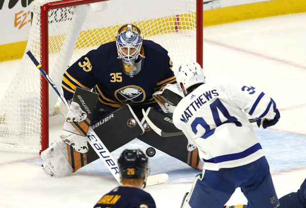 7045e24b5 Buffalo Sabres goalie Linus Ullmark stops Toronto Maple Leafs forward  Auston Matthews during the first period of a game