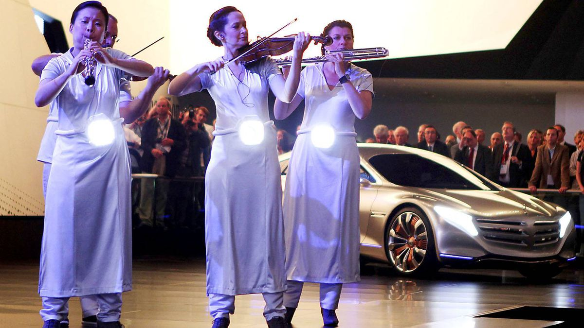 Musicians play during the presentation of Mercedes-Benz at the 64th Frankfurt Auto Show in Frankfurt, Germany, Tuesday, Sept.13, 2011.