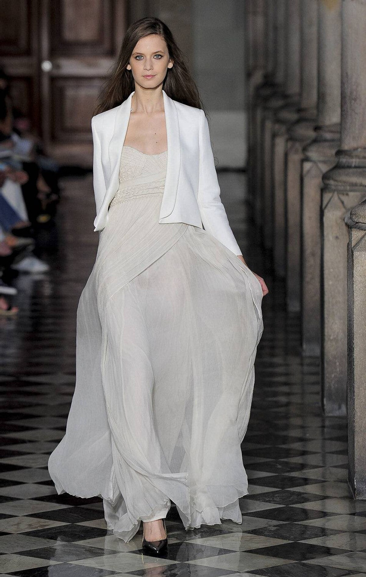 A model presents a creation by Mango during the 080 Barcelona Fashion spring-summer week on July 14, 2011.