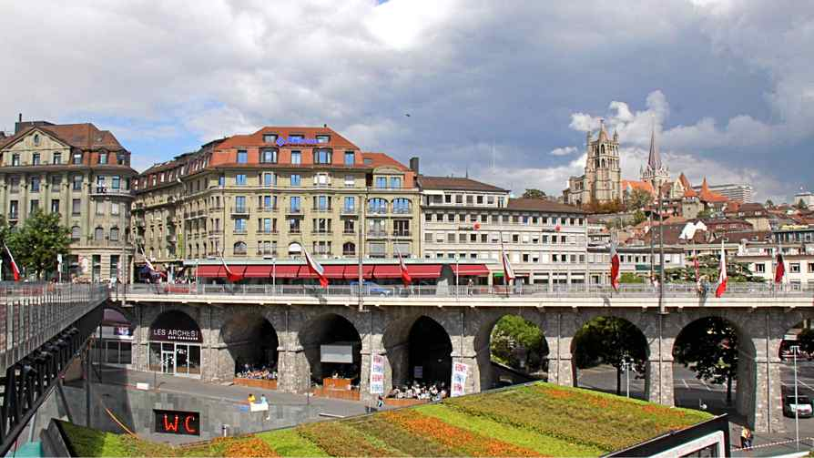 In Lausanne, the funky Flon club and cafe district sits beneath and Grand Pont in Lausanne, while the Gothic catherdral towers over the town.