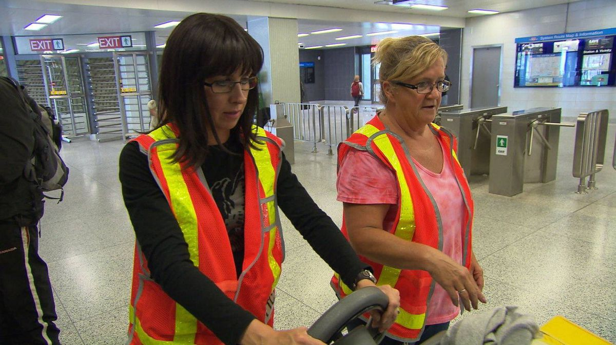 Karen Stintz in disguise as Ruth Bear using the floor buffing machine with 25-year TTC veteran service person Sylvia Butt at Victoria Park Station in Toronto.