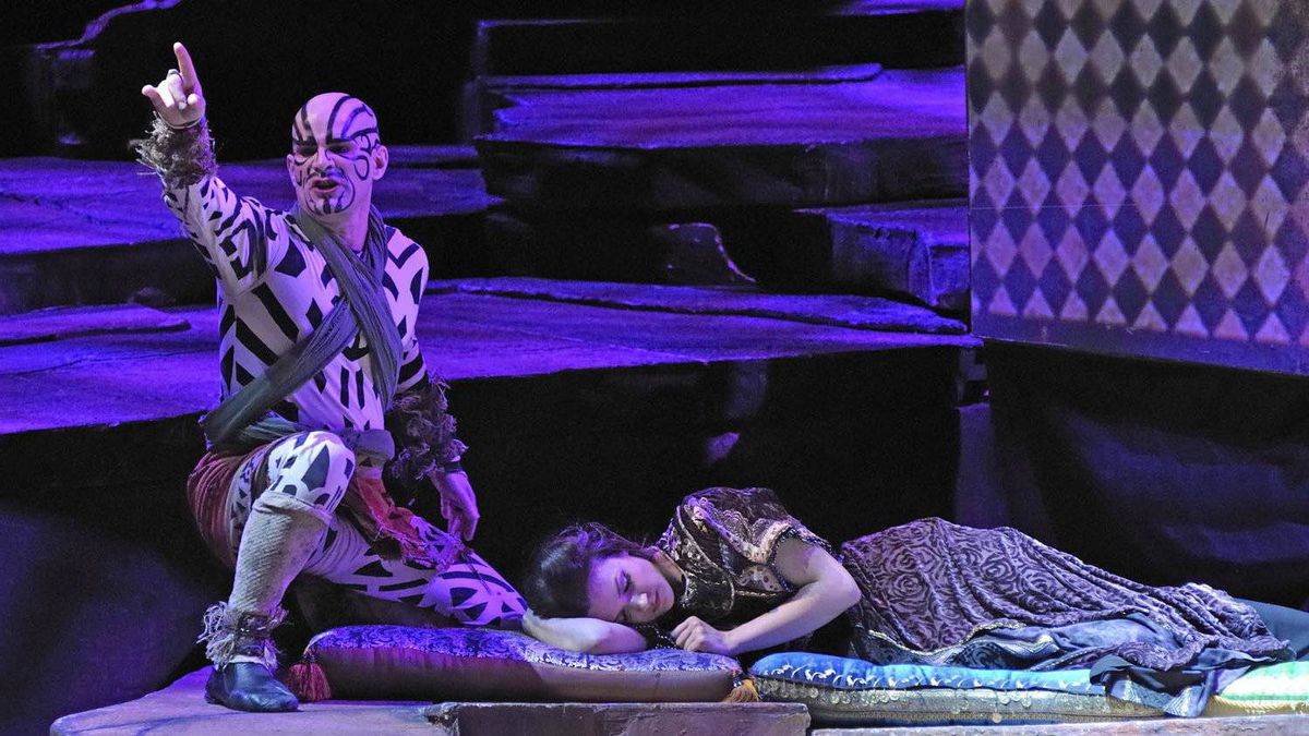 The lecherous Monostatos (Michel Corbeil), a slave in Sarastro's palace, has designs on the sleeping Pamina (Andriana Chuchman) during the Manitoba Opera's production of The Magic Flute.