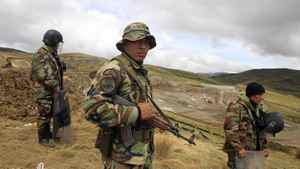 Peruvian police officers guard near machinery of Newmont's proposed $4.8-billion Conga gold mine to protect it from protesters near the Cortada lagoon in the Andean region of Cajamarca.