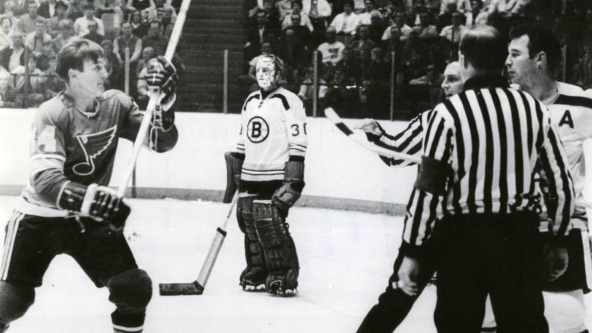 "In a preseason game on Sept. 21, 1969, Wayne Maki (left) of the St. Louis Blues and Boston Bruins defenceman ""Terrible"" Ted Green (right) engaged in a bloody, violent stick-swinging fight. Moments after this photo was taken, Green was hit in the head and suffered a fractured skull and a brain injury."