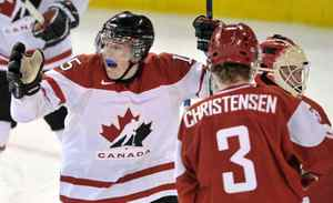 Canada forward Tanner Pearson (15) celebrates Canada defenceman Brandon Gormley's (3) goal as Denmark goalie Sebastian Feuk (30) and Denmark defenceman Jannik Christensen (3) look on during third period IIHF World Junior Championships hockey action in Edmonton on Thursday, Dec. 29, 2011.