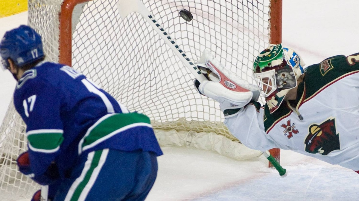 Vancouver Canucks centre Ryan Kesler (17) sends the puck past Minnesota Wild goalie Niklas Backstrom (32) for a goal during first period NHL hockey action in Vancouver Monday, March 14, 2011. THE CANADIAN PRESS/Geoff Howe