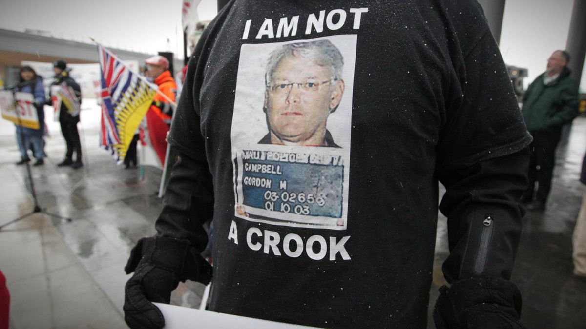 A protester outside the BC Liberal Convention in Vancouver Feb. 26, 2011.