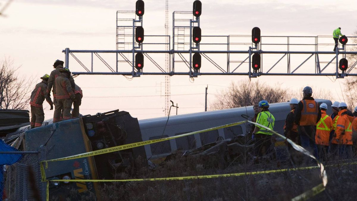 Emergency personnel attend to a VIA Rail passenger train that derailed in Burlington Ontario, February 26, 2012.