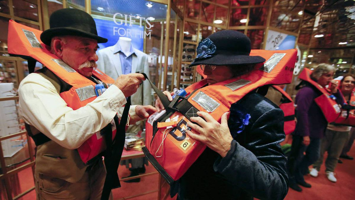 John Philip of South Coast, New South Wales, Australia adjusts the life jacket of his sister, Ann Breust of Canberra, during a drill on board the Titanic Memorial Cruise in Southampton, England April 8, 2012.