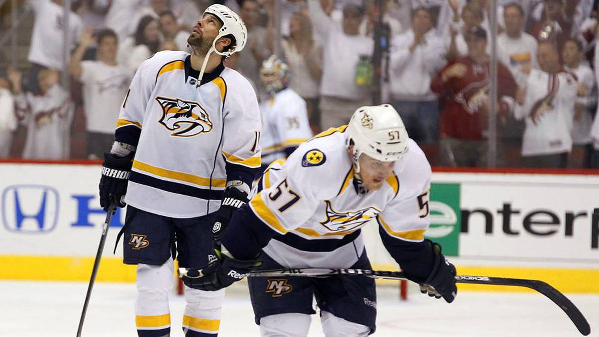 Nashville Predators' Gabriel Bourque and David Legwand head back to the bench after a Phoenix Coyotes' goal.