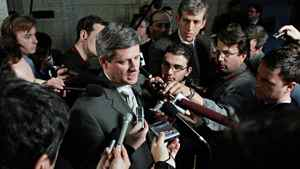 In this May 13, 2005 file photo, Stephen Harper speaks to the media outside the House of Commons on Parliament Hill in Ottawa.