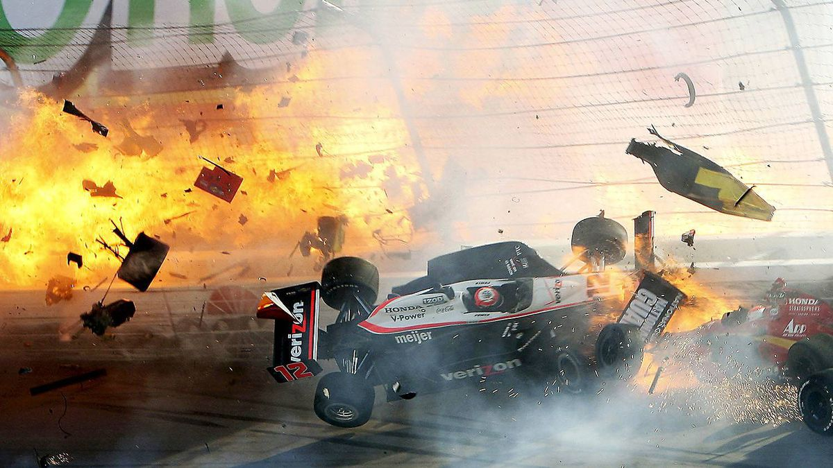 Will Power's car hits the wall as flames from British driver Dan Wheldon's car burst (at left) during the IZOD IndyCar World Championship race at the Las Vegas Motor Speedway in Las Vegas, Nevada October 16, 2011. Wheldon died from injuries sustained in the crash.