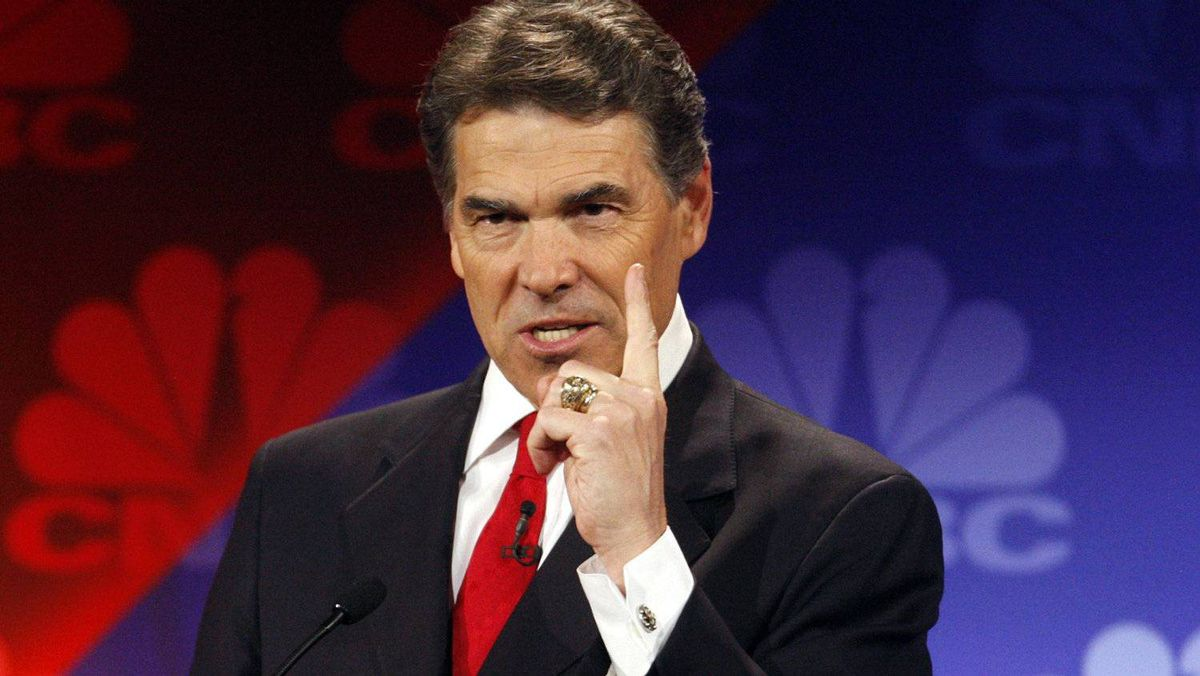 Republican presidential candidate, Texas Governor Rick Perry, gestures as he answers a question at the CNBC Republican presidential debate in Rochester, Michigan, November 9, 2011.