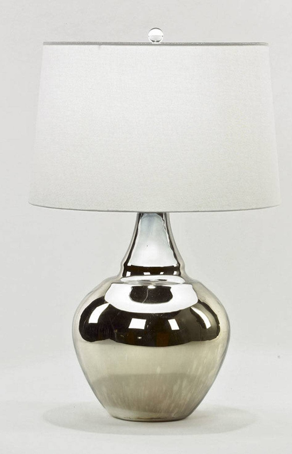 Casalife's Metallic Base table lamp has a nickel base with a glass finial and tapered drum shade. $284 through www.casalife.com.