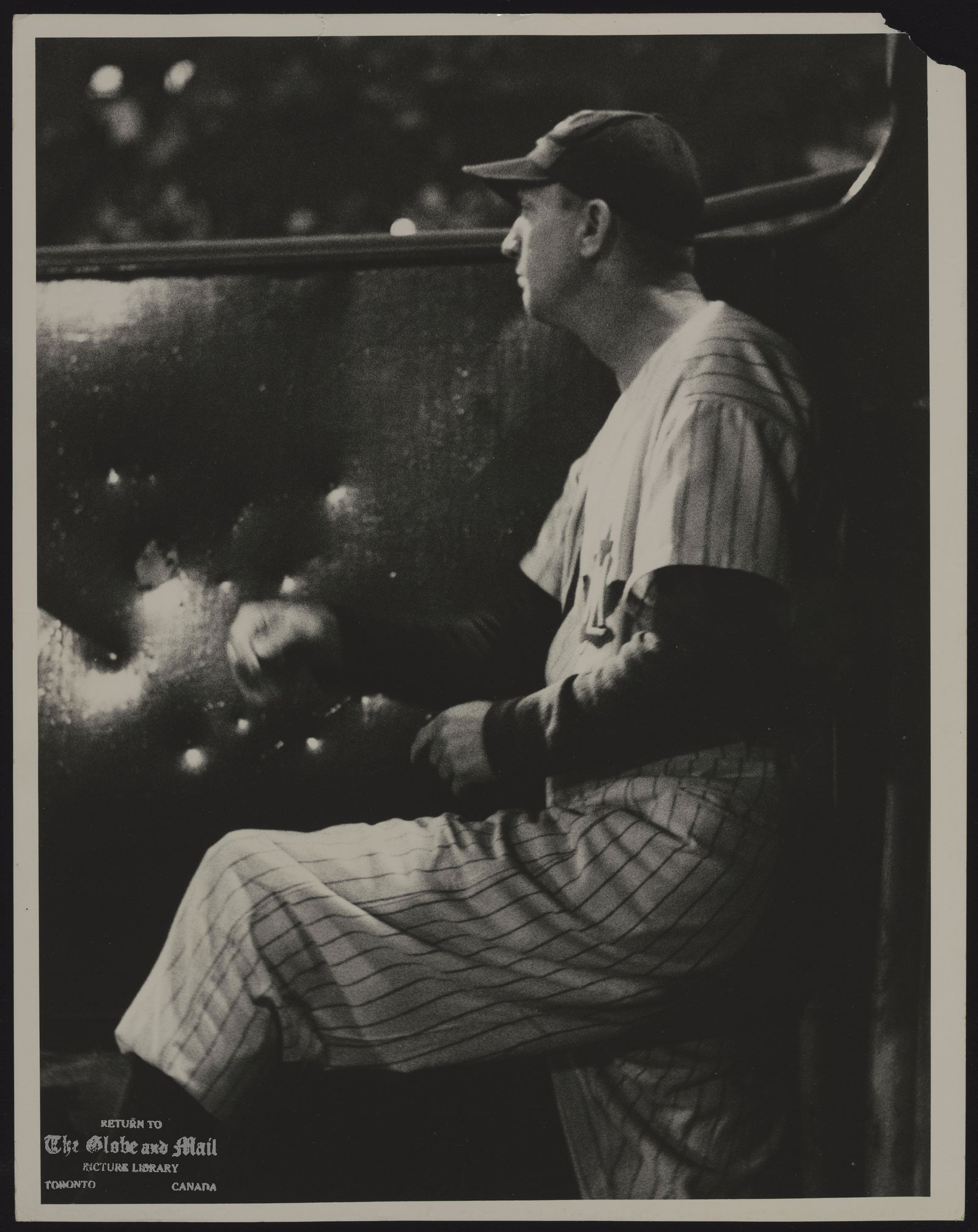 Dixie WALKER [Frederick D. Walker]. Baseball. 1957 From the dugout, Dixie Walker, Toronto Maple Leafs manager and sometime People's Choice of Brooklyn, watches deep drive to the right. [See Globe Magazine article, September 7, 1957]