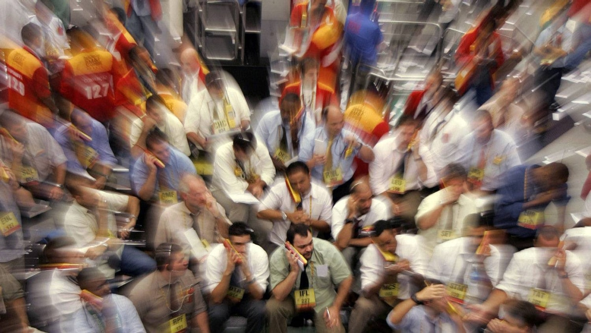 Traders work on the floor of the Brazilian Mercantile and Futures Exchange in Sao Paulo Jan. 23, 2008. Brazilian investment banking giant, BTG Factual, is launching its IPO.