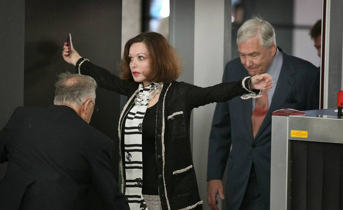 Conrad Black and as his wife Barbara Amiel Black arrive at the Dirksen Federal Building to hear the terms of his bail on July 23 in Chicago.