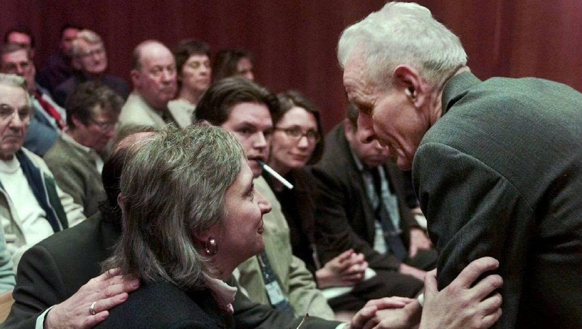 Melody Youk, left, widow of Thomas Youk, meets with Dr. Jack Kevorkian during the murder trial for the retired pathologist in Oakland County Circuit Court in Pontiac, Mich., Thursday, March 25, 1999. Judge Jessica Cooper denied the request by Kevorkian to call Melody, and Youk's brother Terry, as witnesses in the lethal injection death of Thomas Youk. Dr. Kevorkian could get life in prison in Youk's death by lethal injection, which was videotaped and shown on ``60 Minutes'' and was also shown to the jury. (AP Photo/Pool, Gabriel Tate)