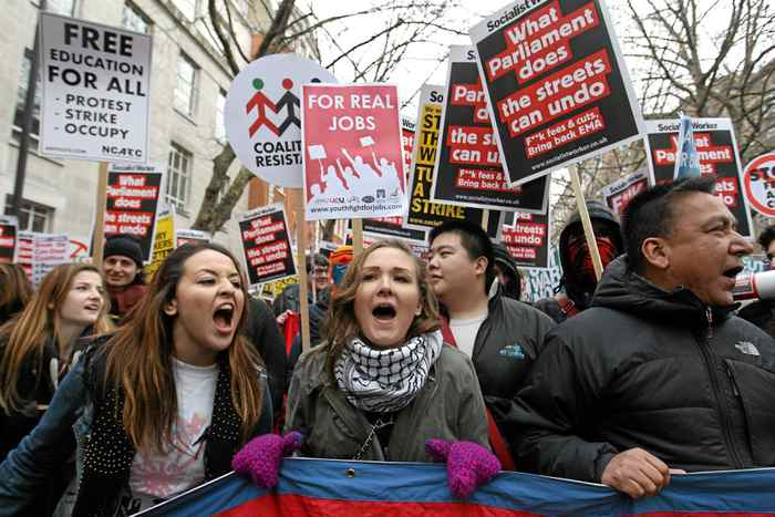 U.K. student demonstrators march to Parliament to protest against the government's cuts to public services and an increase in tuition fees