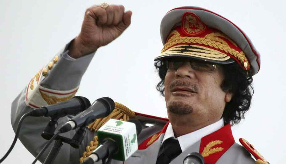 Libyan leader Moammar Gadhafi talks during a ceremony to mark the 40th anniversary of the evacuation of the American military bases in the country, in Tripoli, Libya in June, 2010. Gadhafi was killed October 20th, 2011, after being caught alive in a drainage pipe. The interim Libyan government, under international pressure, has called for an investigation in to his death and allegations that he was executed by government fighters.