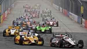 Will Power (12) and Ryan Hunter-Reay (28) lead into the first turn after a restart in São Paulo, Brazil.