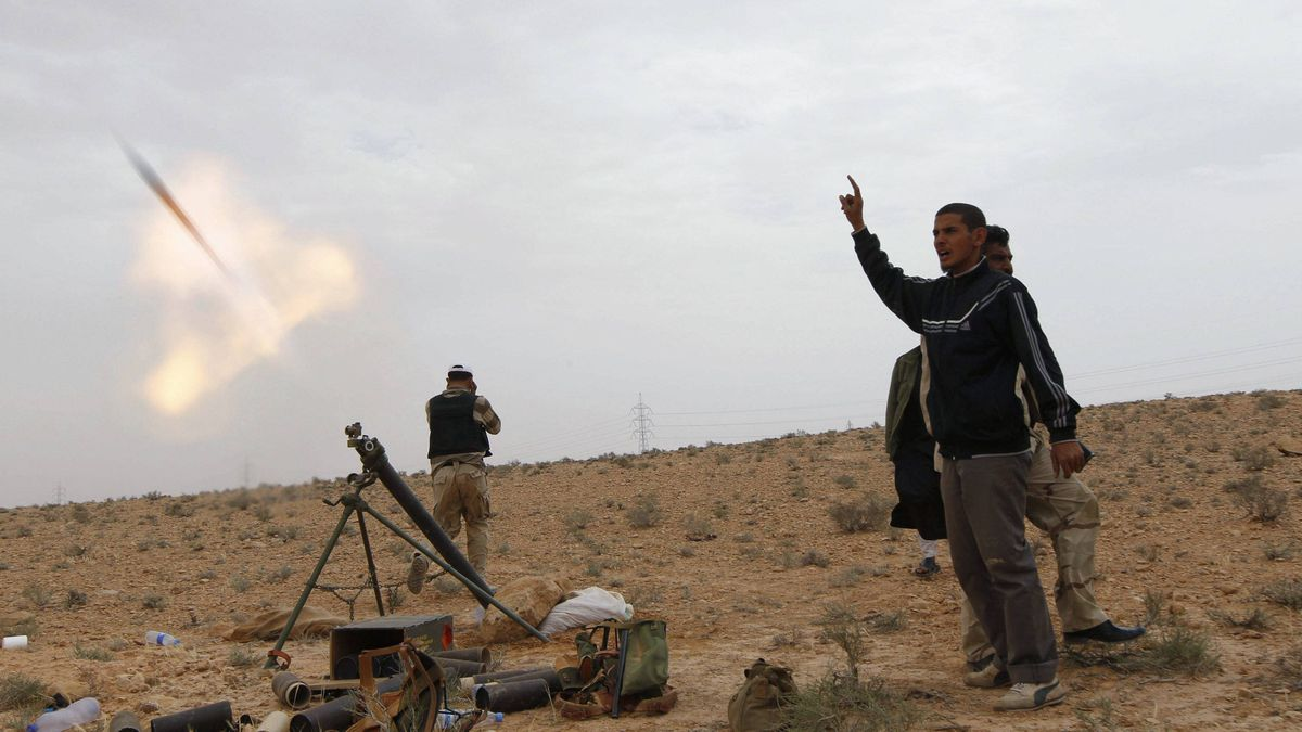 Rebel fighters fire rockets from the frontline, outside the Bir Ayyad gate near the city of Zintan in the Western Mountains, some 120 km southwest of the capital Tripoli, June 6, 2011.