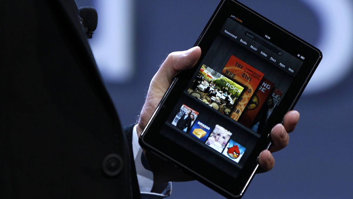 Amazon CEO Jeff Bezos holds up the new Kindle Fire at a news conference during the launch of Amazon's new tablets in New York, September 28, 2011.