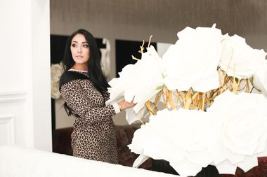 Monica Gomez puts the finishing touches on decor ahead of an event at the Toronto Event Centre.