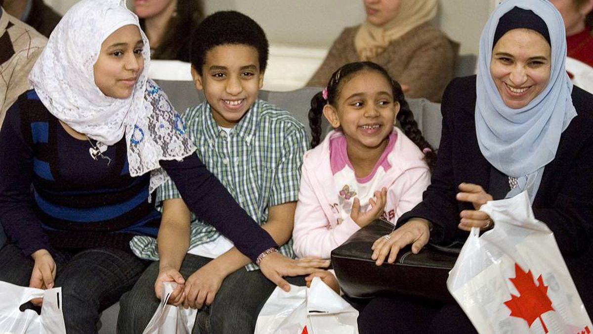 The Amin family celebrates their Canadian citizenship at a ceremony at the legislature in Halifax on Wednesday, Jan. 30, 2008.