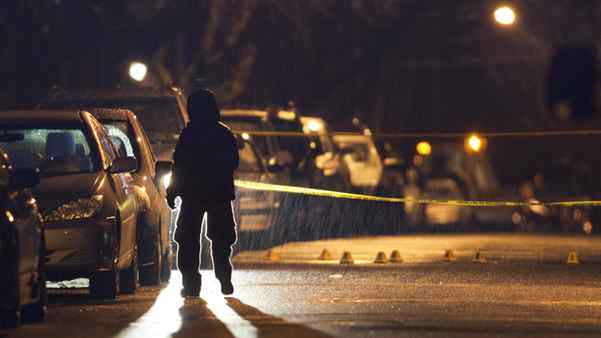 A police officer investigates at a residential neighbourhood in southeast Vancouver after a woman was shot to death in a vehicle. Ben Nelms for The Globe and Mail