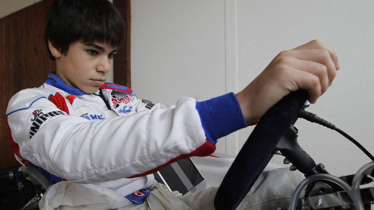 Kart driver Lance Stroll of Canada checks his vehicle ahead of a training session at the South Garda Karting circuit in Lonato, northern Italy December 15, 2011. Photo: Alessandro Garofalo