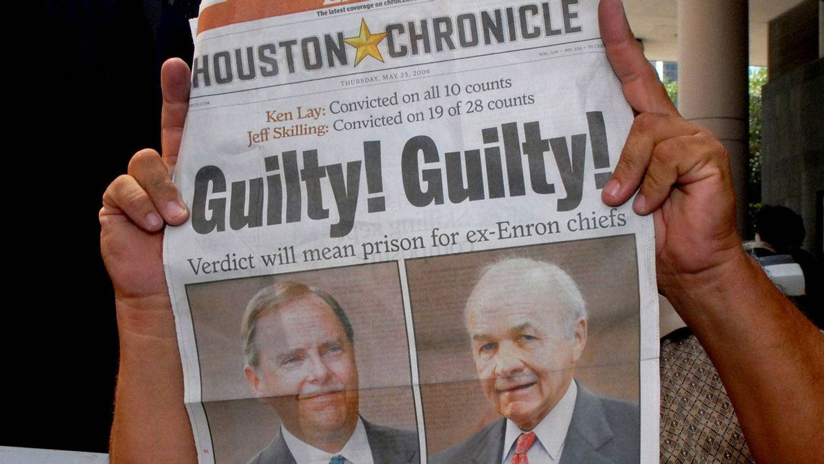 A newspaper vendor holds up a paper with a banner headline outside the federal courthouse after Enron founder Ken Lay and former CEO Jeff Skilling were convicted in Houston May 25, 2006.