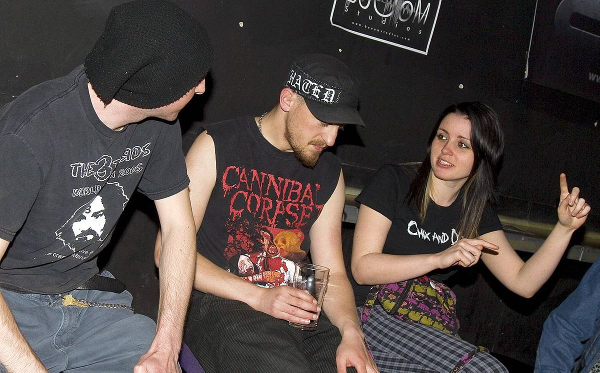 Montreal, May 21, 2010-- Talk Sick band members Dorian (L), and Jesse (C) discuss work with promoter Jessica Kaye, prior to their performance in Montreal, May 21, 2010. Christinne Muschi for the Globe and Mail