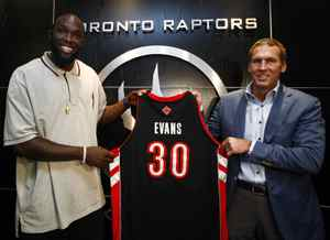 Newly acquired Toronto Raptors forward Reggie Evans, left, and Raptors president and general manager Bryan Colangelo pose for a photograph in Toronto on Tuesday, June 16, 2009.